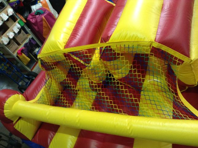 repaired netting on a bounce house
